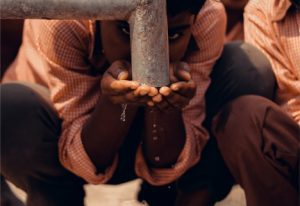 A school child drinking water from the tap