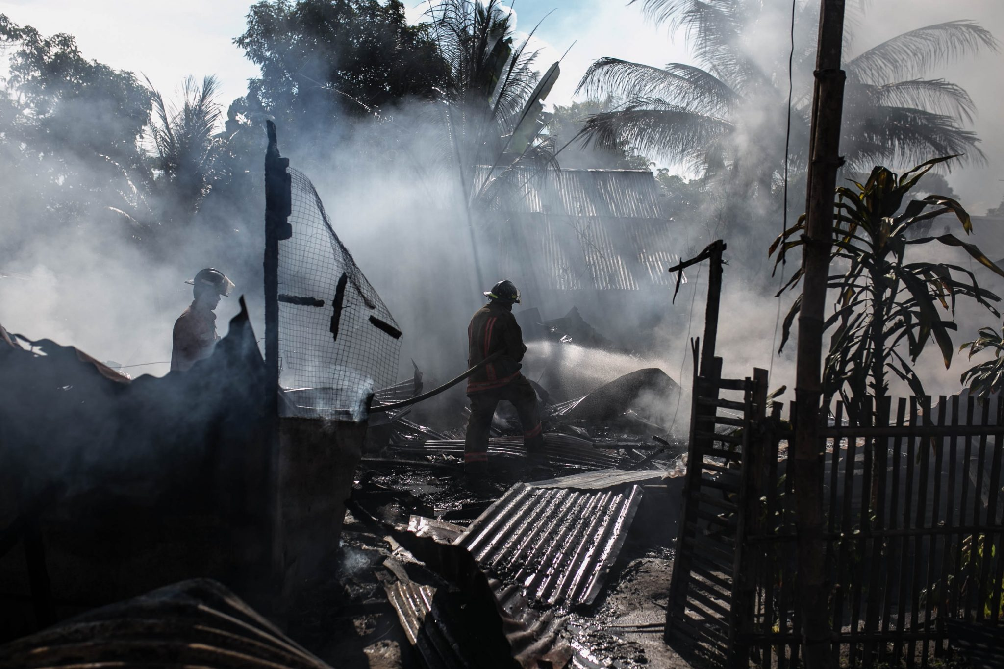 Firefighters putting out a fire in a disaster scene