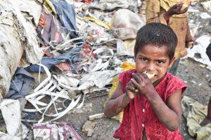 A nutrition deprived child eating food