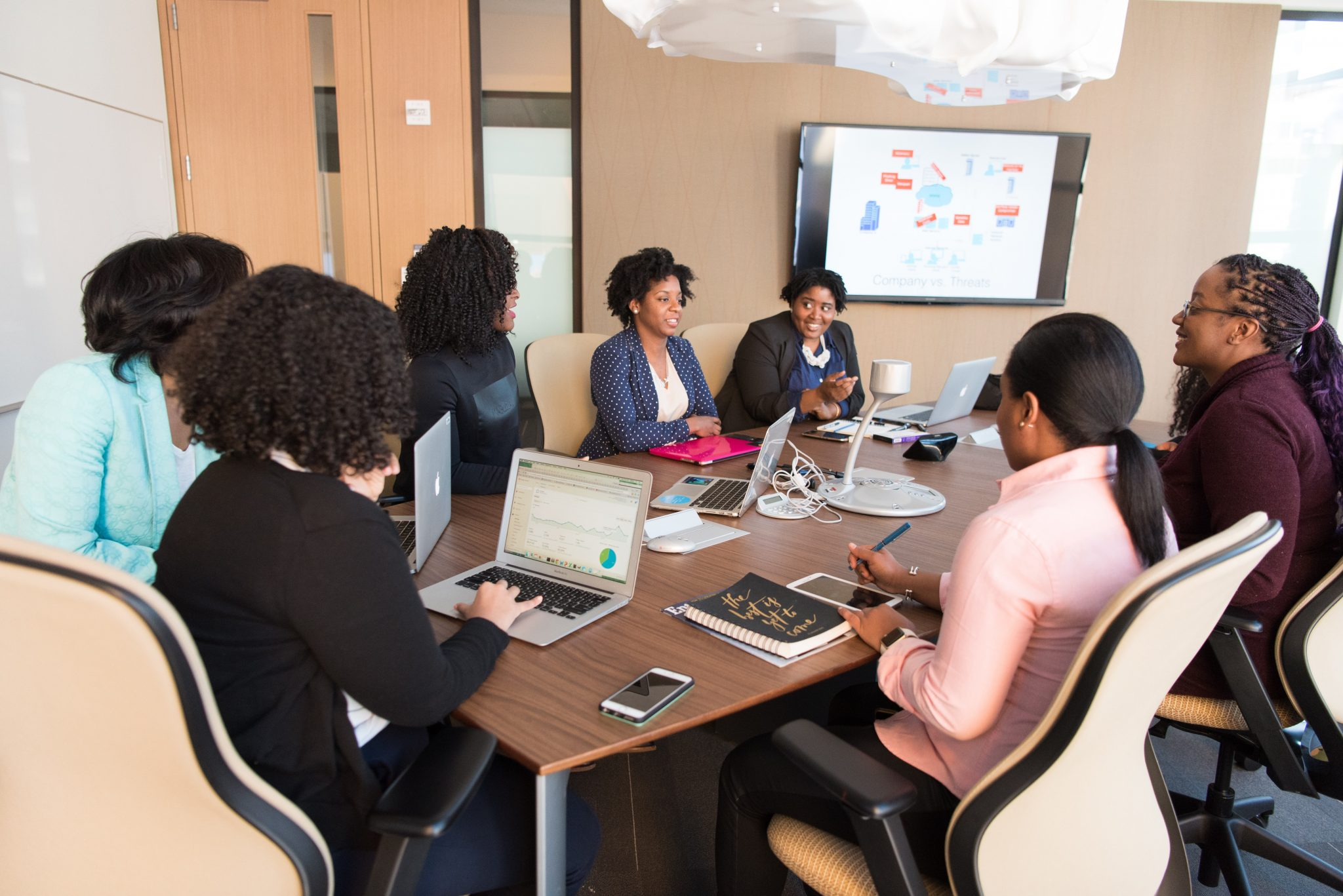 Women learning Monitoring and Evaluation in a Training Workshop