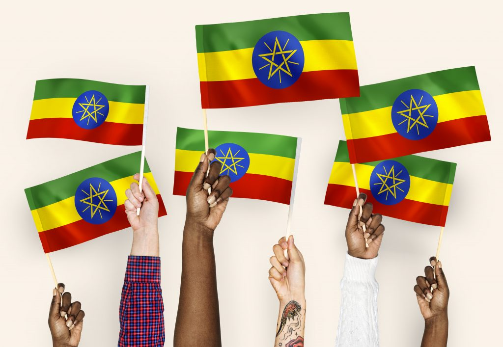 Hands waving flags of Ethiopia